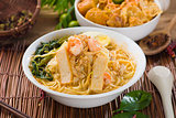 malaysian famous prawn noodle or har mee with decorations on bac