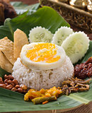 nasi lemak , malay traditional rice meal served with egg