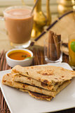 chapati Paratha Fold with traditional indian items background