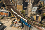 Train on a bridge in London, tilt-shift effect