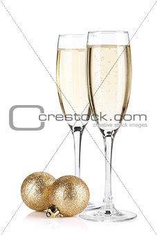 Champagne glasses and christmas balls