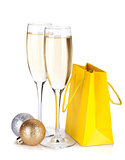 Champagne glasses, christmas baubles and gift bag