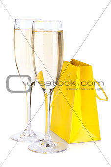 Champagne glasses and gift bag