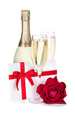 Two champagne glasses, letter and rose