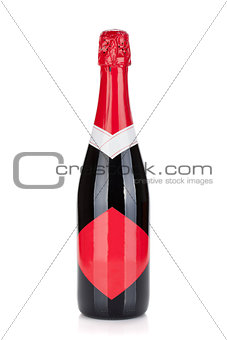 Champagne bottle with red label