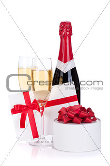 Champagne bottle, glasses and gift