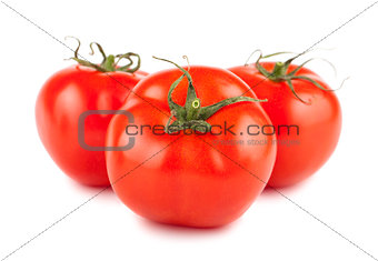 Three ripe red tomato