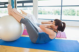 Women using exercise ball for sit ups