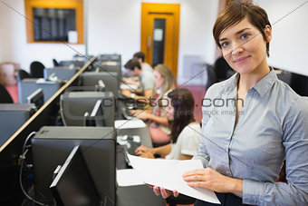 Teacher standing at the computer room