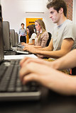 Students sitting at the computer working