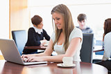 Woman sitting at the coffee shop using laptop