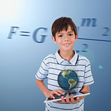 Little boy holding a tablet with a holographic globe hovering over it