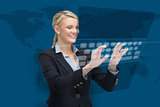 Businesswoman standing while typing on projected keyboard