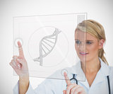 Woman looking at DNA helix interface
