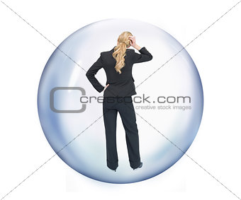 Businesswoman standing at a bubble reverse