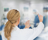Doctor standing at the surgery with digital interface