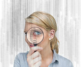 Woman standing holding a magnifying glass