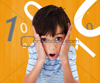 Boy looking scared against orange background