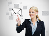 Businesswoman standing while touching email symbol