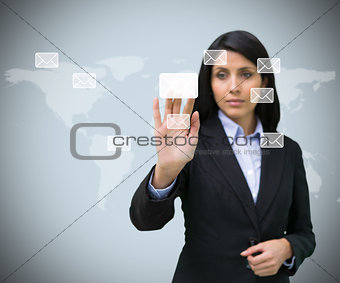 Businesswoman pushing email symbol