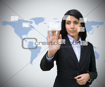 Businesswoman selecting email symbol