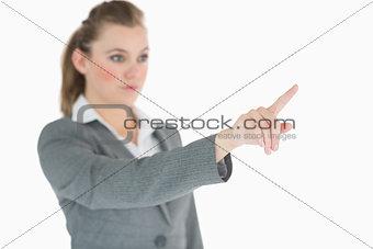Blonde businesswoman raising her finger