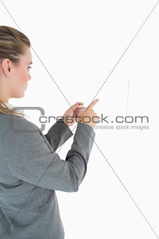 Blonde woman touching glass slide