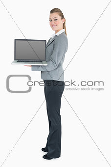 Blonde woman holding a laptop