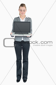 Smiling businesswoman presenting a notebook