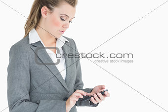 Businesswoman touching on smartphone