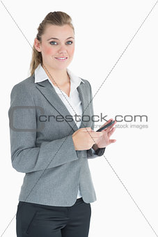 Businesswoman texting while smiling
