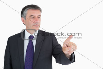 Businessman pressing on something