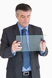 Businessman holding a glass slide