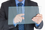 Man touching clear pane