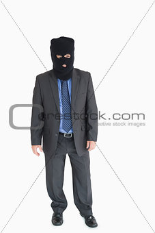 Businessman wearing a balaclava