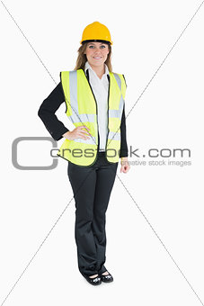 Woman in a suit wearing builder's clothes