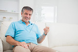 Man holding a pane while sitting on the sofa