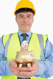 Man holding piggy bank with money