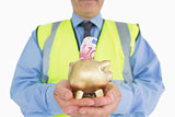 Man in vest holding a piggy-bank