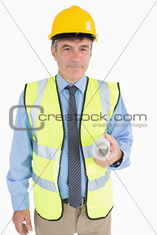 Man in helmet and vest holding a plan