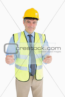 Architect smiling while holding a glass slide