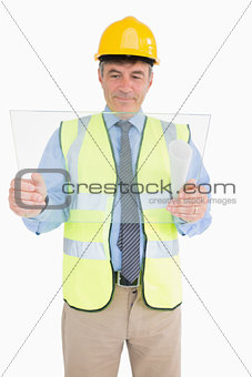 Smiling architect holding a pane