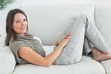 Happy woman relaxing on sofa