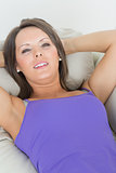 Calm woman lying on sofa