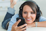 Woman using her smartphone and listening to music