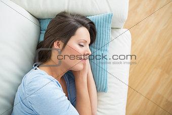 Calm woman lying and sleeping on sofa