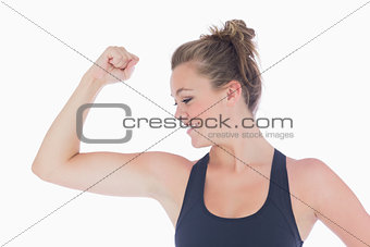 Woman standing showing her muscles