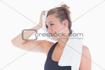 Woman smiling while holding towel at her forehead
