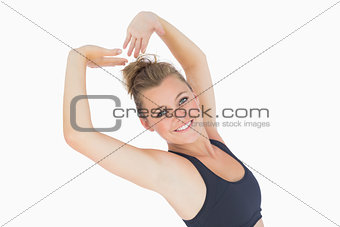 Woman leaning back smiling and stretching