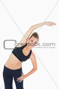 Woman leaning to the right and stretching